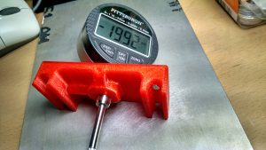 Digital meter installed in a red PLA jig