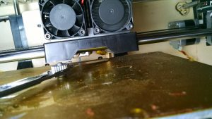 How to check the depth of clearance on a printhead with a feeler guage