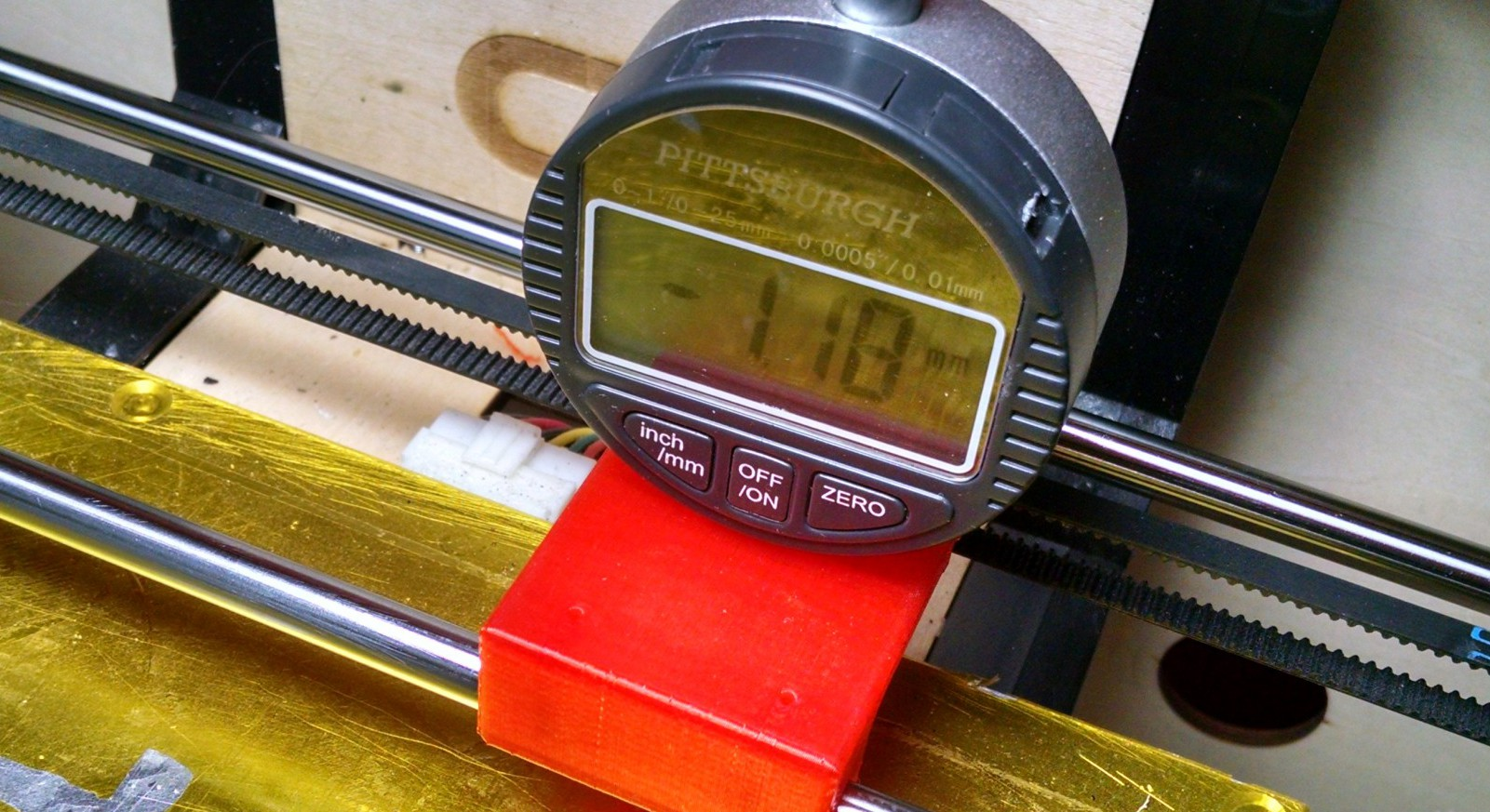 Digital gauge sitting on a 3D printed Jig for leveling the bed of a 3D printer