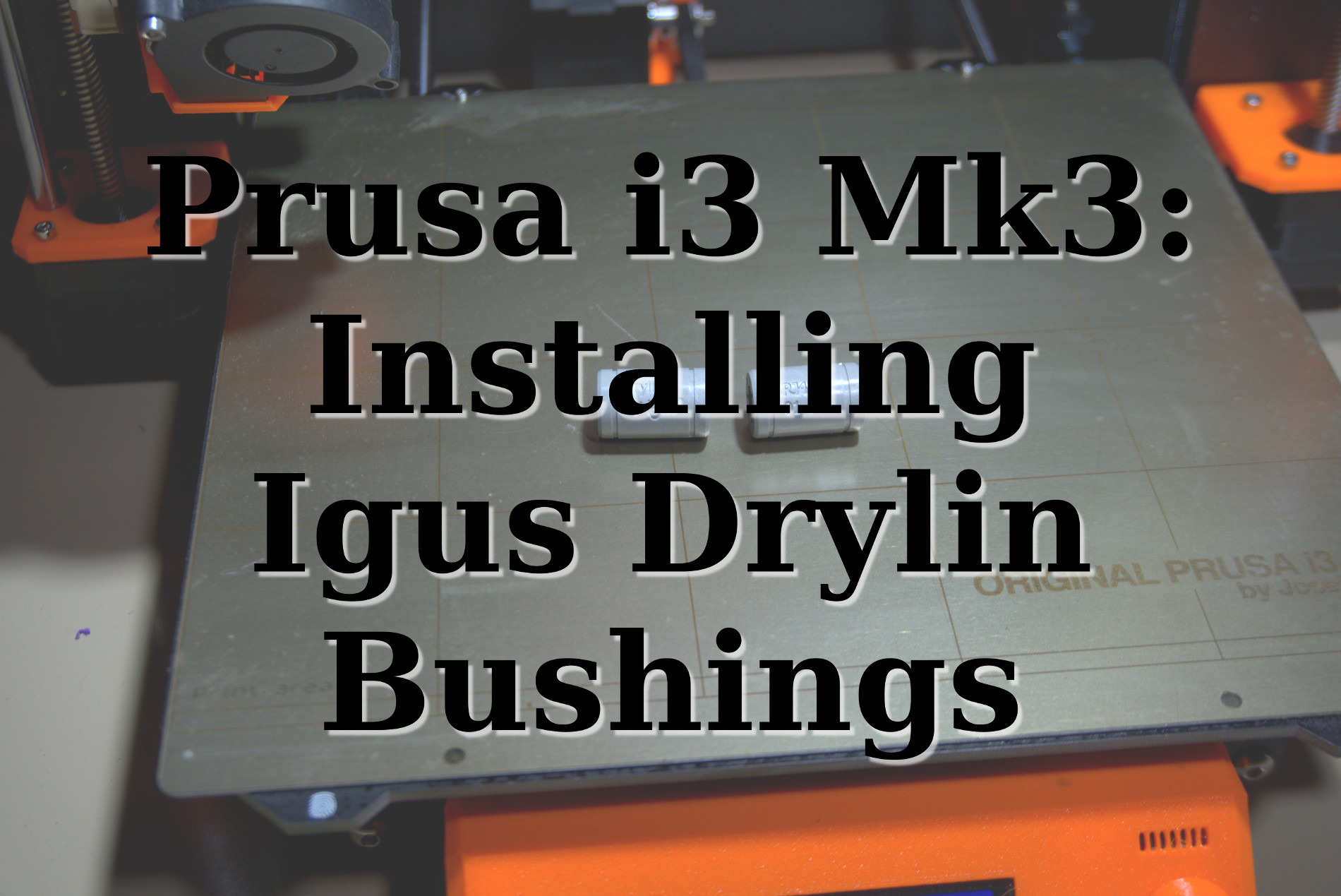 Image of Igus Drylin bushings sitting on a Prusa i3 Mk3 printbed
