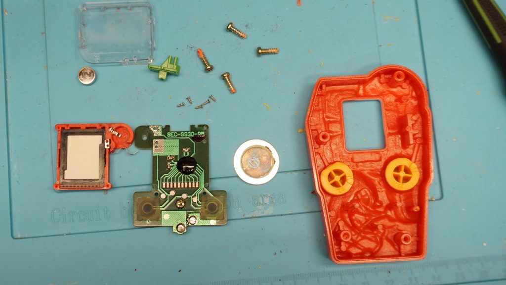 Inside components and case of McDonalds Sega Knuckles Soccer handheld LCD Game